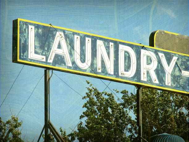 old neon laundry sign stock photo