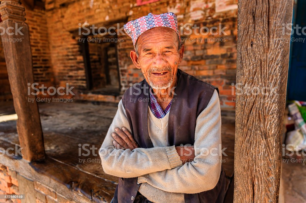 Old Nepali man resting in Bhaktapur stock photo