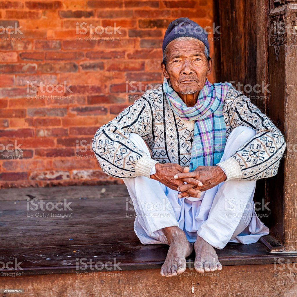 Old Nepali man resting in Kathmandu stock photo