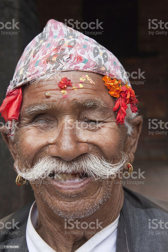 Old Nepali man with traditional hat stock photo
