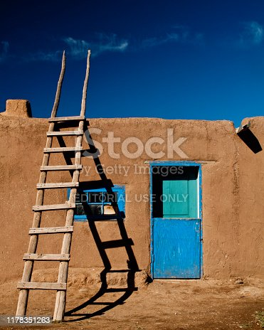 Taos, New Mexico / USA – November 6, 2011: Adobe structures have been built for centuries in the Southwest United States.