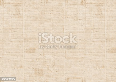 istock Old newspaper texture background 924249790
