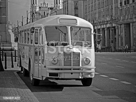 Old nostalgic bus parked on the street. Black and white photo.