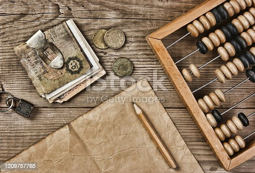istock Old notes and coins and abacus 1209757765