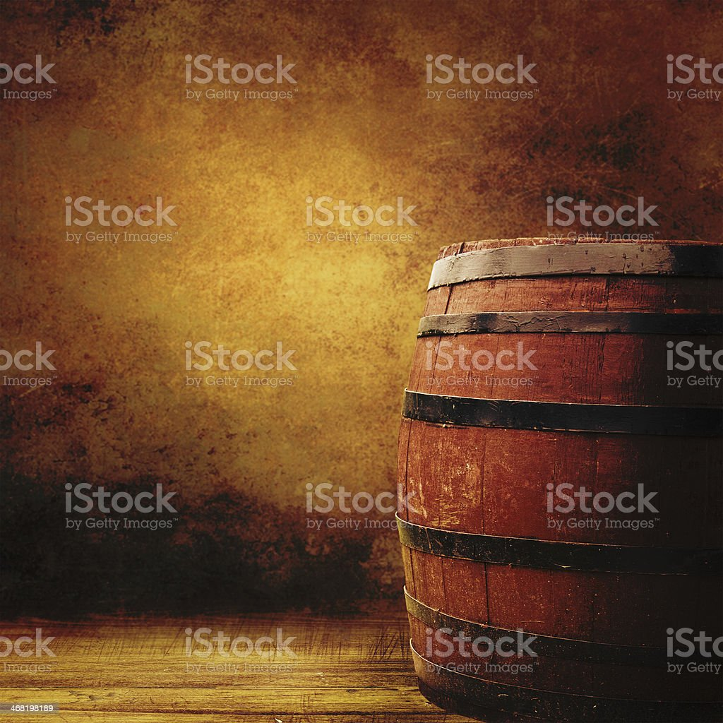 Old oak barrel on a wooden table. stock photo