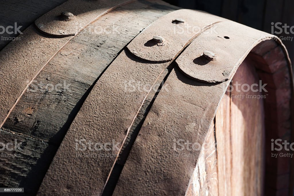 Old oak rusty barrels in cellar, Madeira Island. stock photo