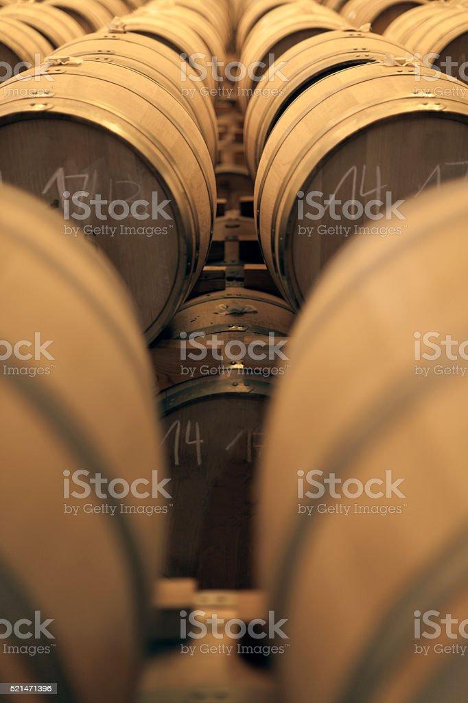 Old oak tree whiskey barrels in a storage warehouse stock photo