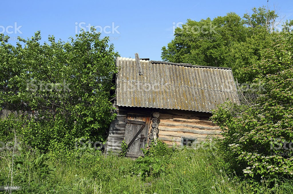 old obsolete bath-house in lush foliage royalty-free stock photo