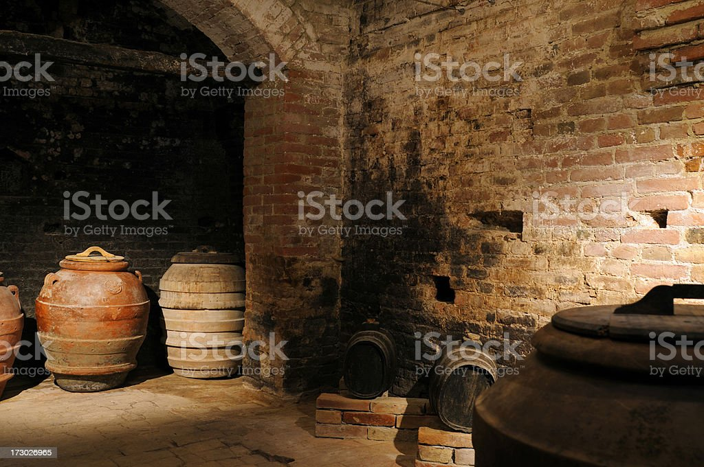 old oil barrels in a cellar royalty-free stock photo