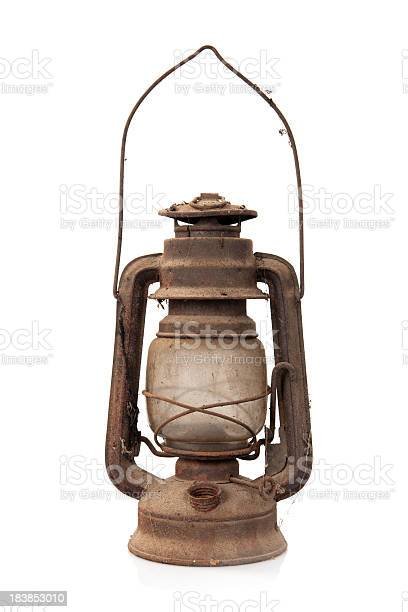 Old rusty oil lamp on white background