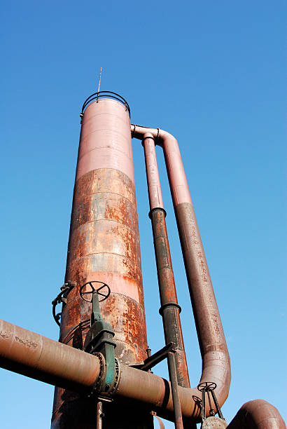 old oil refinery silo stock photo