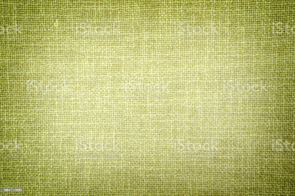Old olive color cloth texture high contrasted with vignetting effect foto stock royalty-free
