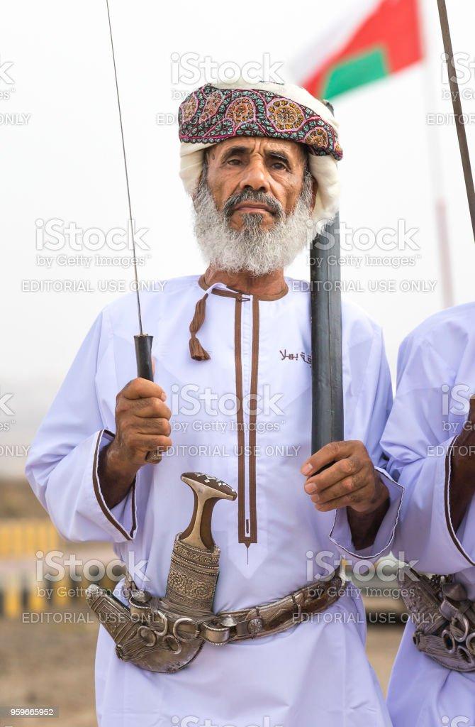 old omani man with khanjar on his belt stock photo