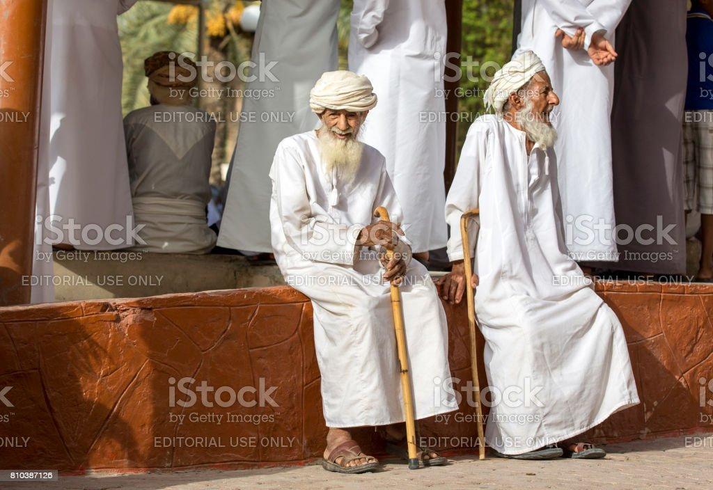 old omani men socialising at a Nizwa goat market stock photo