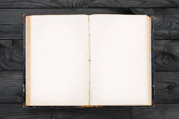 old open book with blank pages on wooden table - hardcover book stock pictures, royalty-free photos & images