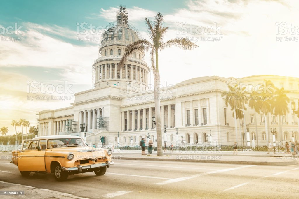 old orange american car in front of Capitol in Havanna stock photo