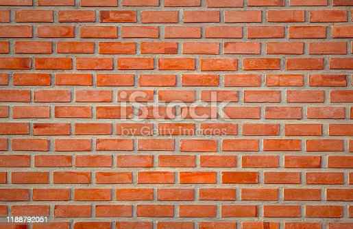 Old Orange brick wall concrete or stone texture background, wallpaper limestone abstract to flooring and homework/Brickwork or stonework clean grid uneven interior rock old. Copy space.