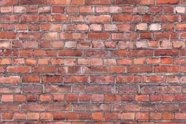 old orange brick wall seamless background stock photo
