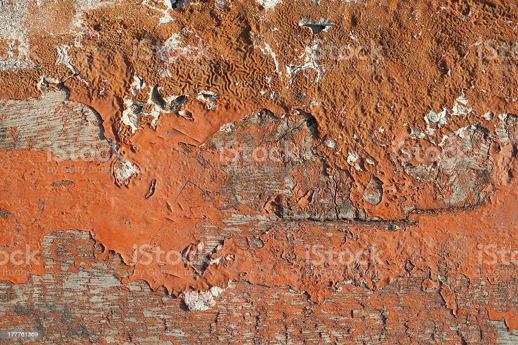 old orange paint texture peeling off wood plank background royalty-free stock photo