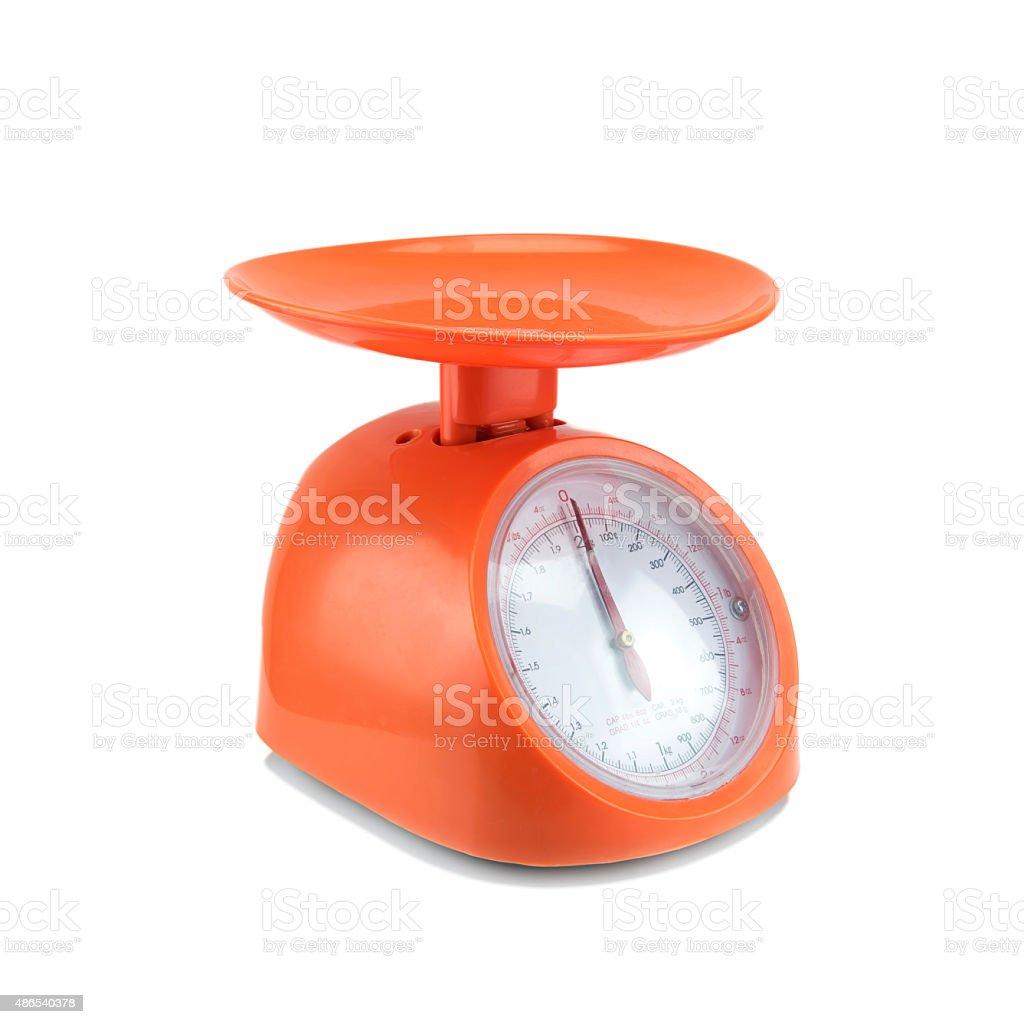 Old orange scale isolated on white background. stock photo
