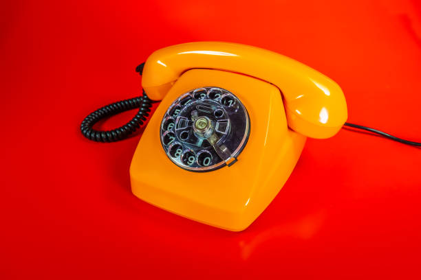 Old orange telephon stock photo