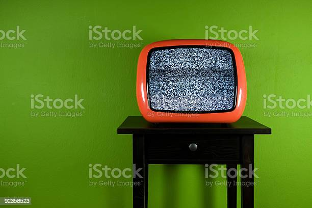 Old Orange Television With Interruption In Green Room Stock Photo - Download Image Now