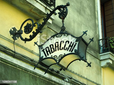 an old deco ornate italian tobacconists sign tabacchi = tobacco
