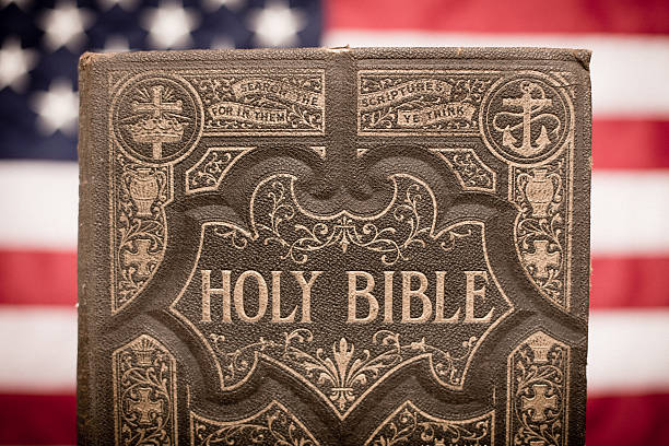 Old Ornate Holy Bible With American Flag Background Stock Photo