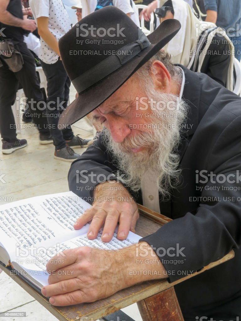 old orthodox jewish man studying holy texts near the wailing wall in jerusalem, Israel, March 8, 2018 royalty-free stock photo