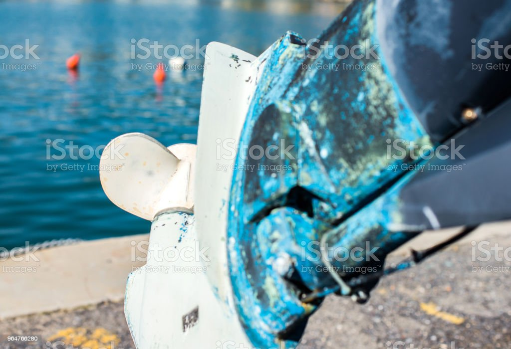 Old outboard with peeling paint. royalty-free stock photo