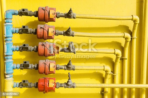 istock Old outdoor home water valve and water meter 524455867