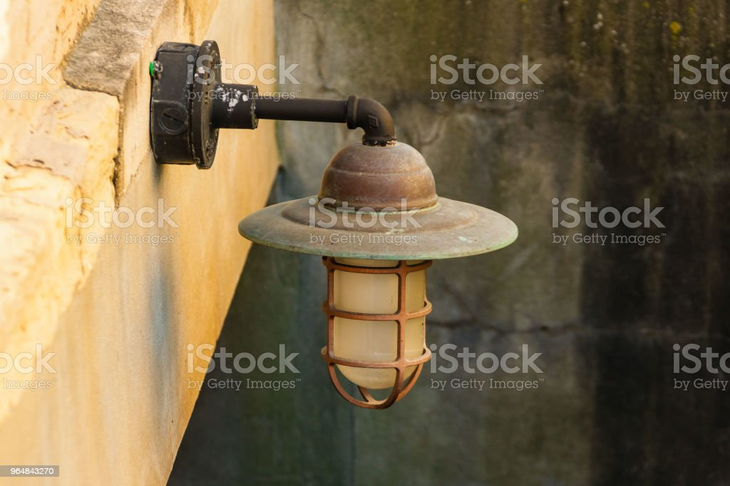 old outdoor light fixture in a stairwell royalty-free stock photo