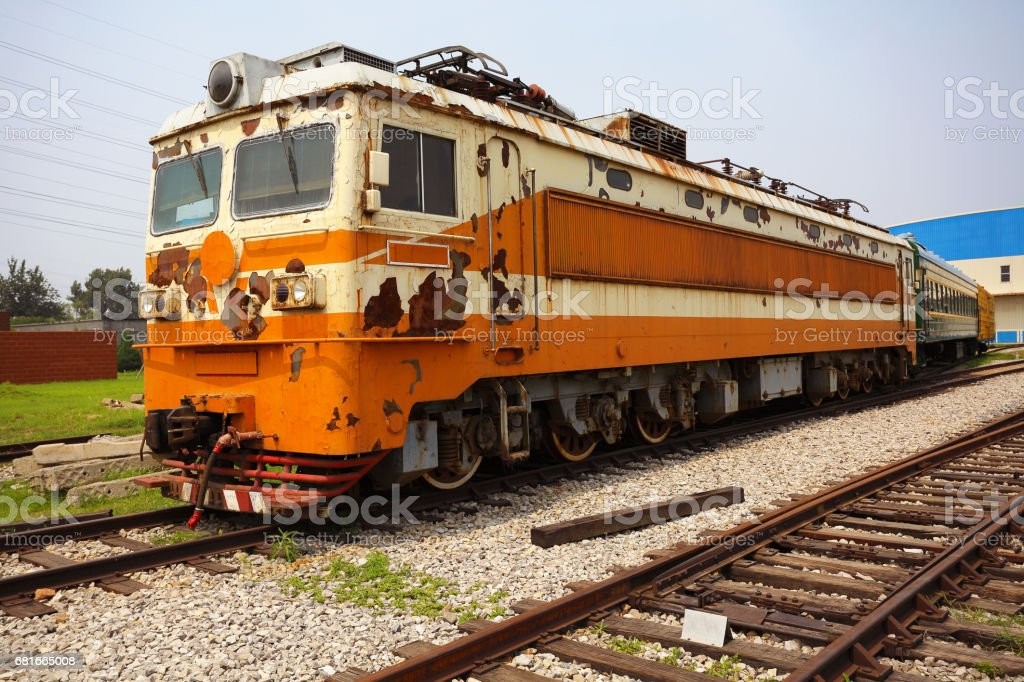 Old out-of-date rust yellow train locomotive stock photo
