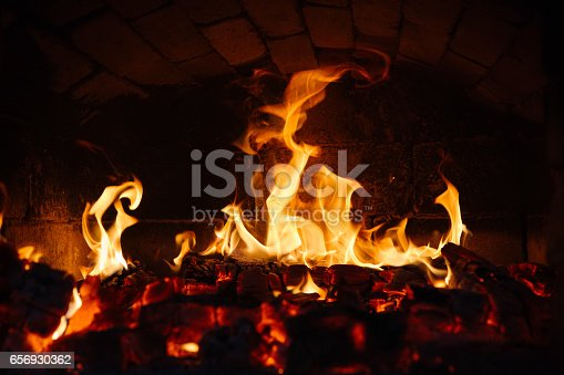 istock old oven with flame fire 656930362