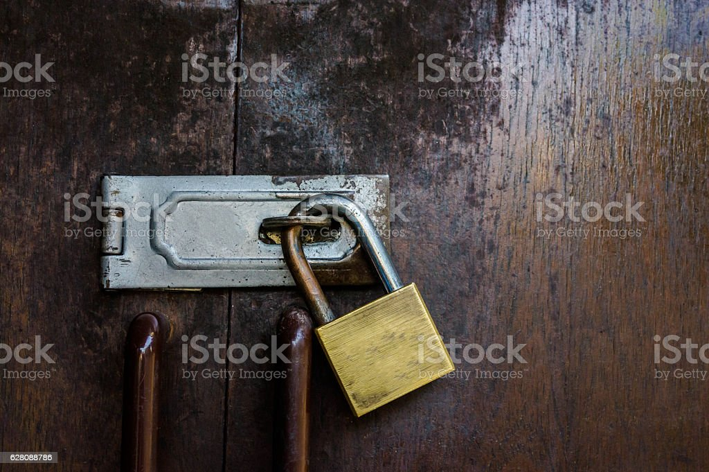 Old padlock on a wooden doorWooden Gate Lock stock photo & Royalty Free Padlocked Door Pictures Images and Stock Photos - iStock