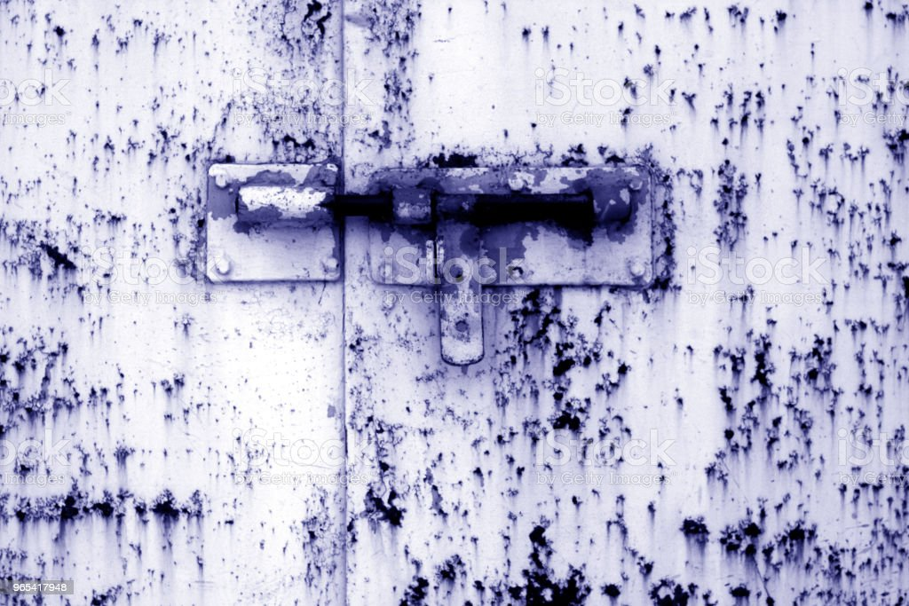Old padlock on metal gate in blue tone. royalty-free stock photo