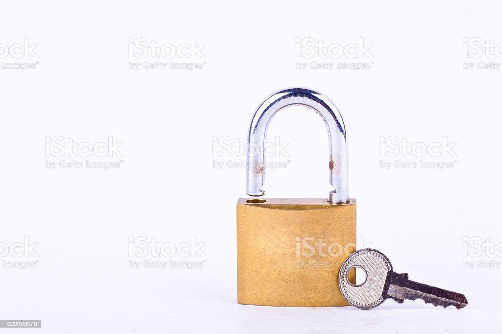 old padlock or master key and key on white background stock photo