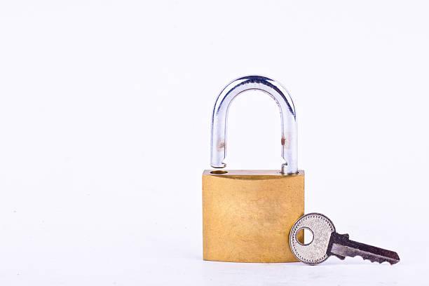 old padlock or master key and key on white background – Foto