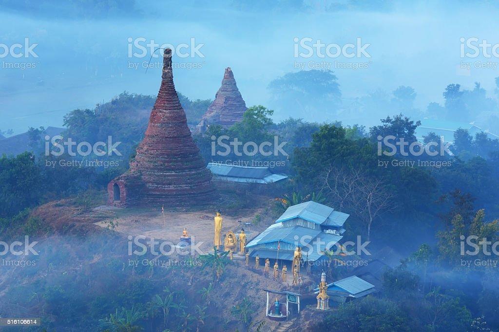 Old pagada with fog morning in Mrauk U, Myanmar stock photo
