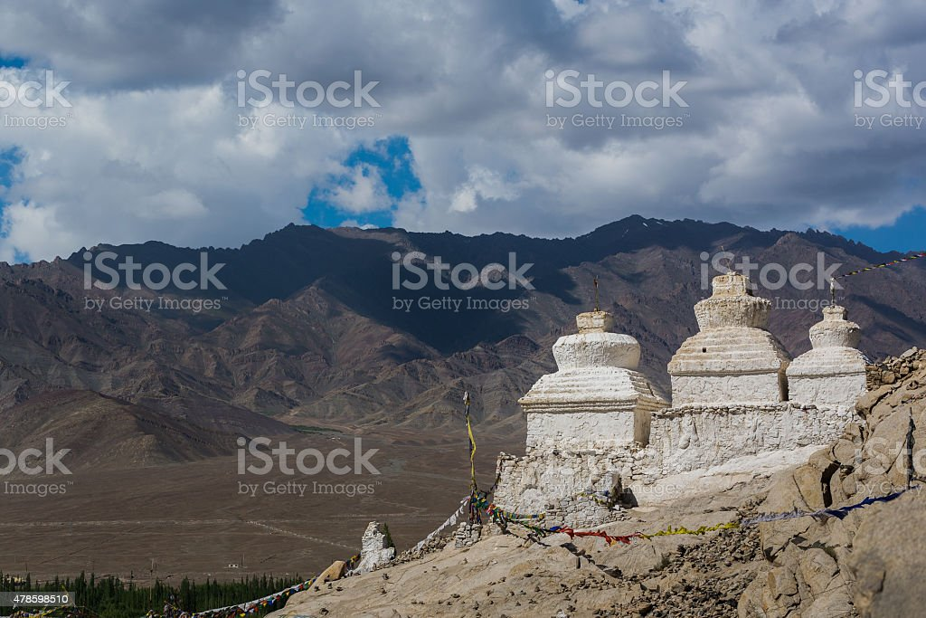 Old pagodas with mountain view at Shey Palace. stock photo