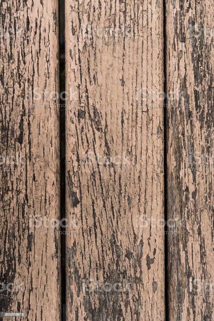 Old paint cracks on wooden surface background royalty-free stock photo