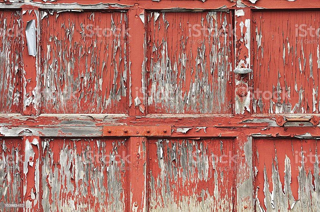 old paint peeling from garage door royalty-free stock photo
