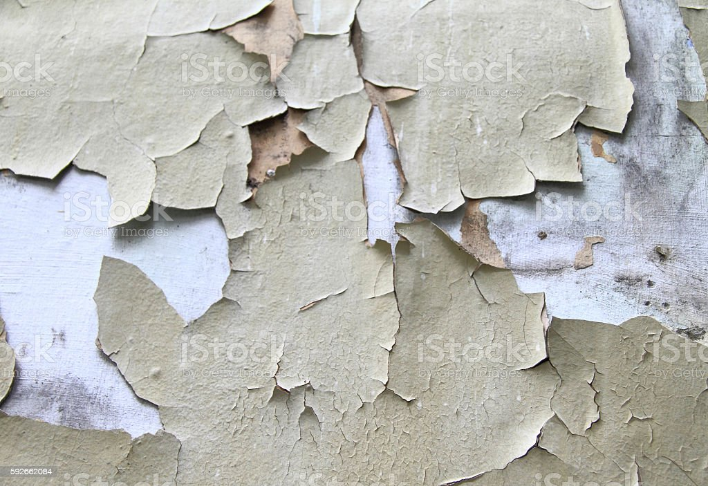 Old paint peeling from wall background stock photo