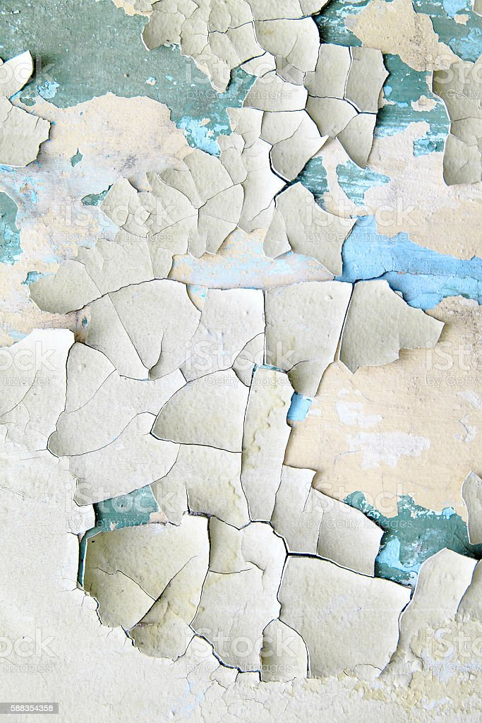 Old paint peeling from wall close up stock photo