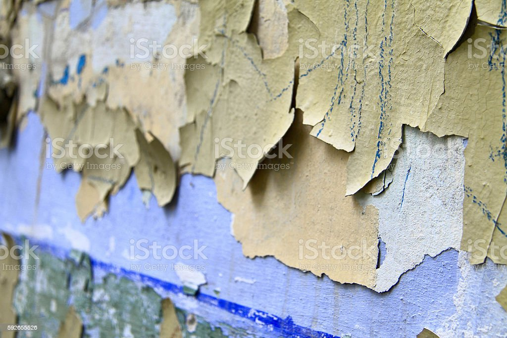 Old paint peeling from wall stock photo