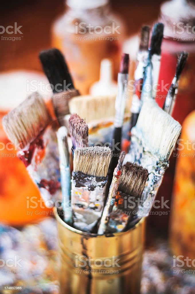 Old paintbrushes inside a can royalty-free stock photo