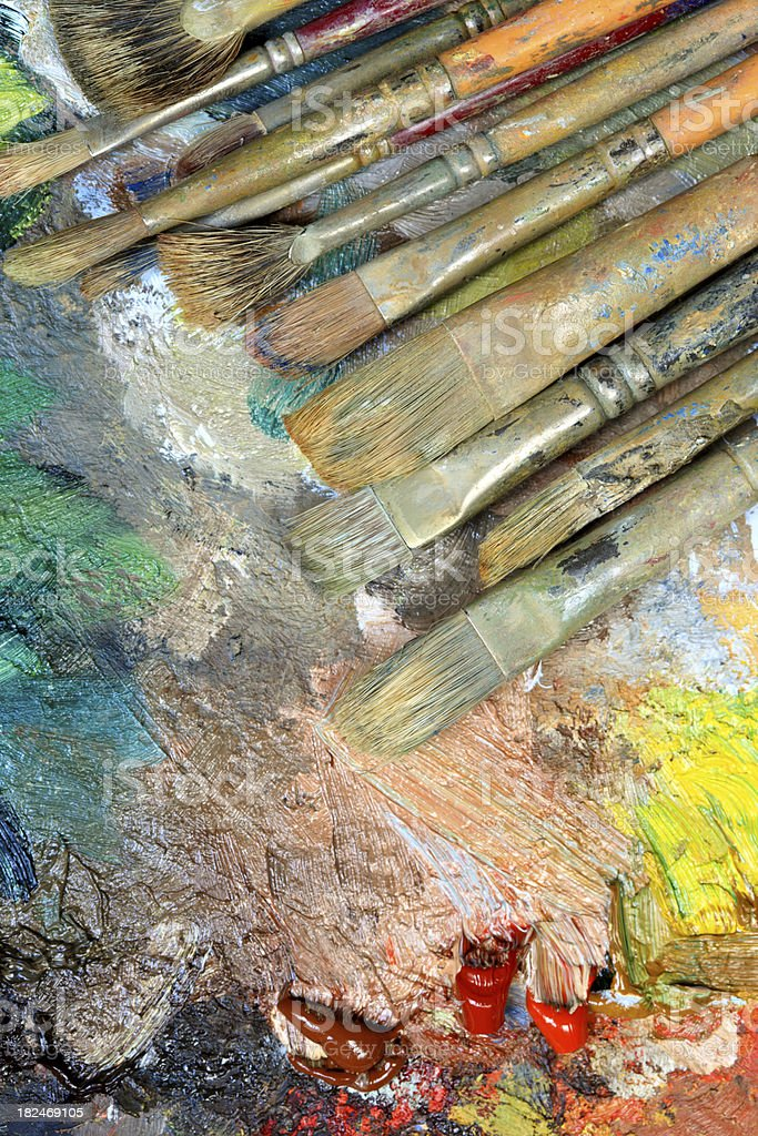 Old paintbrushes on a palette royalty-free stock photo