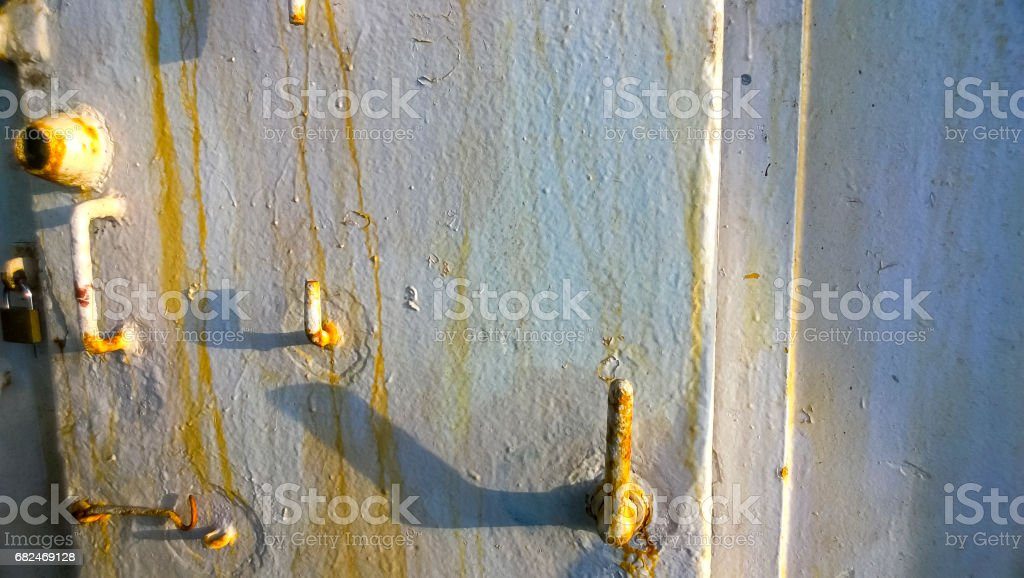 Old painted doors with traces of rust. The door to the storage r royalty-free stock photo