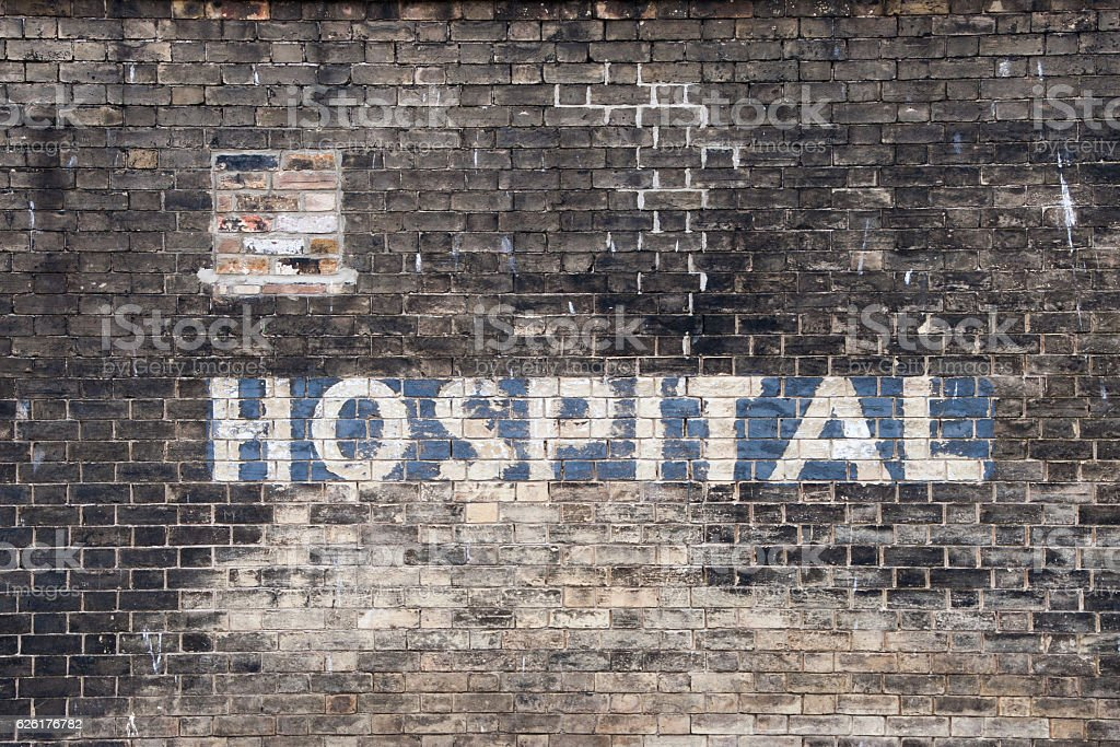 Old Painted Hospital Sign stock photo
