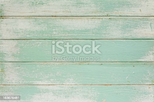 istock Old painted wooden board background. 163676481